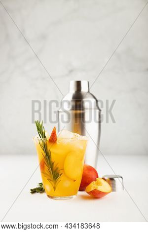 Cooking Of Homemade Organic Cold Peach Smoothie With Ice, Green Rosemary Twig, Sugar Rim, Fruit Slic