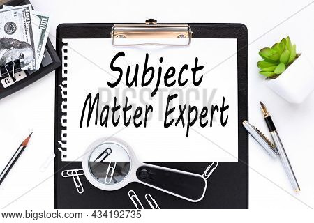 Business Acronym Sme As Subject Matter Expert. Text On A White Sheet Of Paper Near A Magnifying Glas