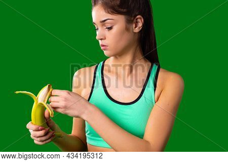 Slim Refined Muscle Girl Making Fitness And Follow A Healthy Diet For Her Figure To Maintain It In A