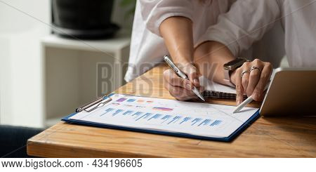 Close Up Business Adviser Meeting To Analyze And Discuss The Situation On The Financial Report In Th