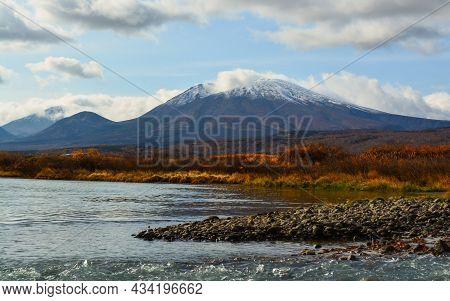 Volcano In A River Valley, In Kamchatka