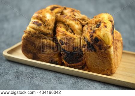 Bread With Dried Shredded Pork And Chili Paste Placed In Rectangle Wood Dish