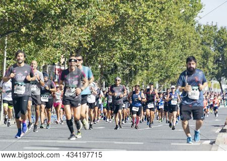 Madrid, Spain - September 26, 2021. Group Of Popular Athletes Walking The Streets Of Madrid Doing Th