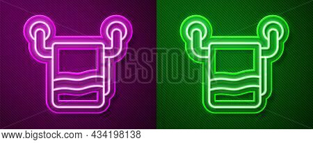 Glowing Neon Line Towel On A Hanger Icon Isolated On Purple And Green Background. Bathroom Towel Ico