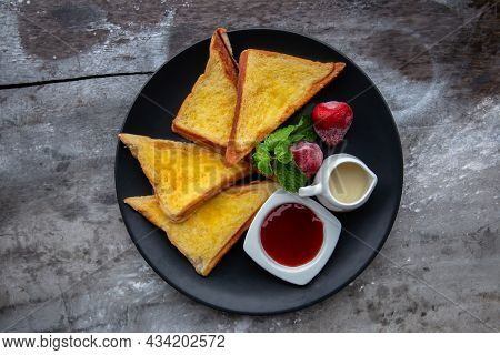 Buttered Bread And Strawberry Jam On A Plate Are The Appetizers Of Restaurants In Rural Thailand.