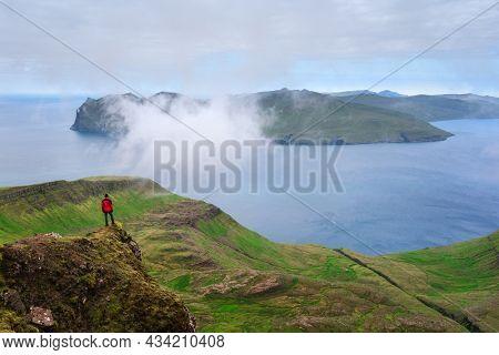 Hiking on Streymoy Island, Faroe Islands. View from Sornfelli mountain of Vagar Island