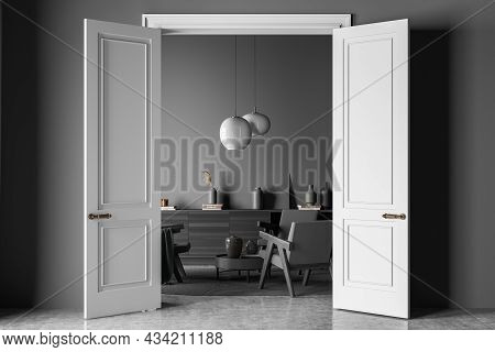 Dark Living Room Interior With Three Armchairs, Carpet, Doors, Coffee Table, Sideboard And Concrete