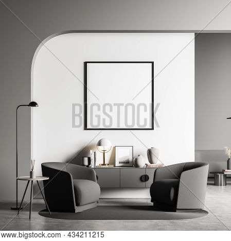 Empty Square Frame In The Seating Area With Grey Design. Archway, Two Armchairs, Sideboard, Neat Det