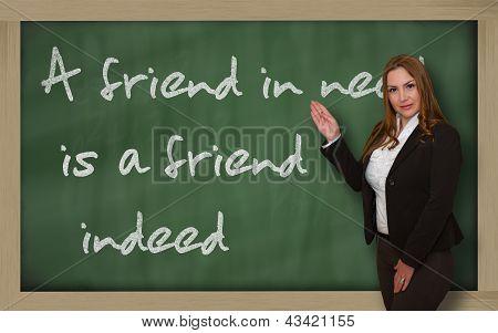 Teacher Showing A Friend In Need Is A Friend Indeed On Blackboard