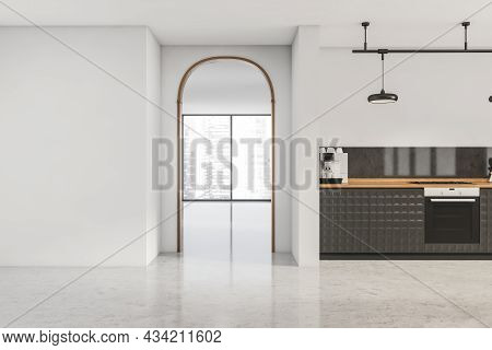 Archway To The Next Panoramic Area And White Kitchen Interior With Textured Black Cabinets And A Fra