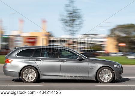Side View Of The Gray Bmw 5 Series. Motion Blur. Riga, Latvia - 09 Sep 2021.
