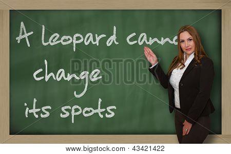 Teacher Showing A Leopard Cannot Change Its Spots On Blackboard