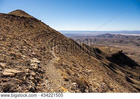 Narrow Trail Clings To The Hill Side Overlooking Salt Basin In Guadalupe Mountains National Park