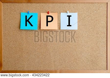 Kpi Word Written In Stickers Attached To The Cork Board.  Key Performance Indicator Concept.
