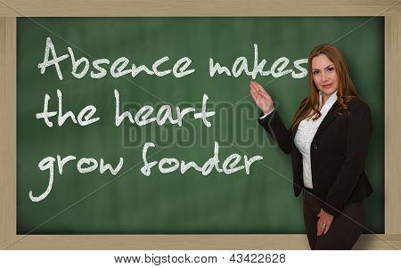 Teacher Showing Absence Makes The Heart Grow Fonder On Blackboard
