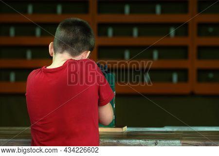 A Teenage Boy Shoots A Gun At A Shooting Range At Targets