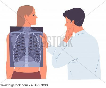 Doctor Looks At The X-ray Of The Patients Lungs