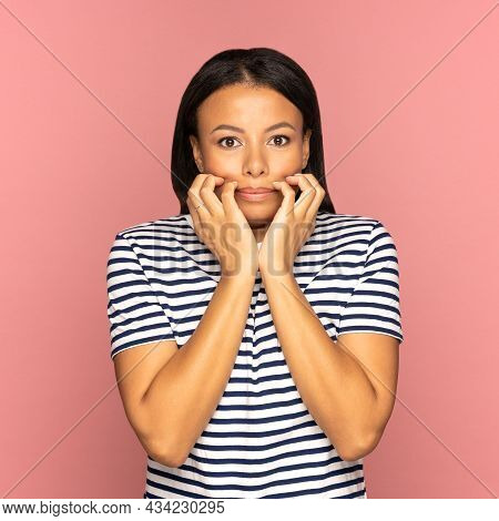 Frightened African American Girl Holding Folded Hands Together Look Scared And Shocked. Desperate An