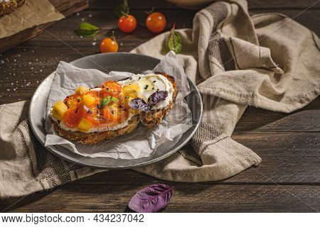Italian Bruschetta With Roasted Tomatoes, Mozzarella Cheese, Pineapple Slices And Herbs On A Metal P