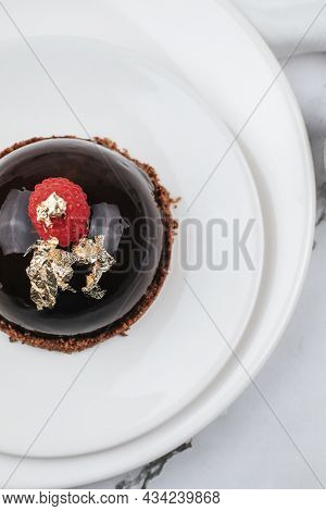 Chocolate Mousse With Fresh Berries On Marble Table. Modern European Desserts. Shallow Focus