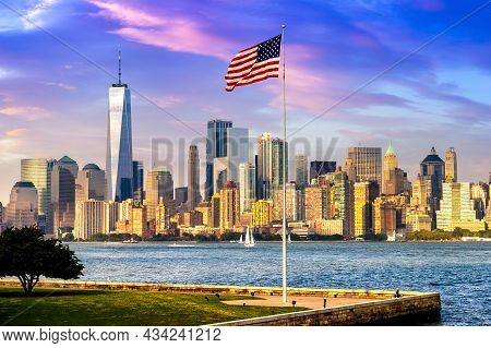 Panoramic View Of Manhattan Cityscape And Usa Flag In New York City At Sunset, Ny, Usa