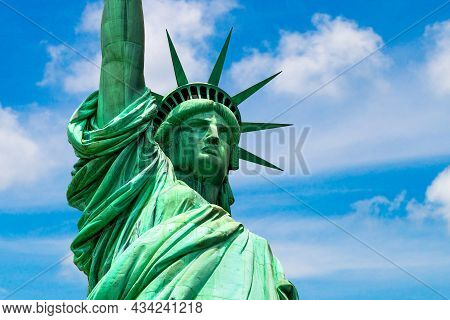 Statue Of Liberty Against Blue Sky With Beautiful Cloud Background In New York City, Ny, Usa