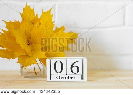 October 6 On The Calendar And A Bouquet Of Bright Autumn Leaves On The Table.one Of The Days Of The