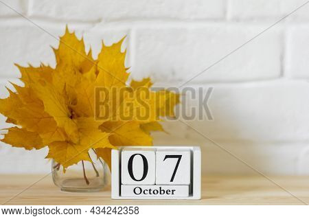 October 7 On The Calendar And A Bouquet Of Bright Autumn Leaves On The Table.one Of The Days Of The