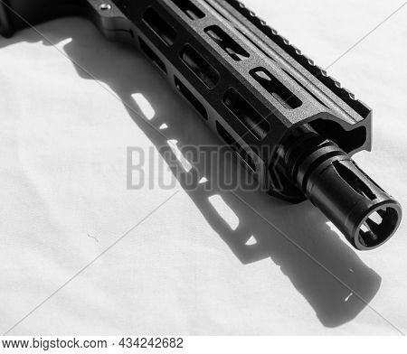 The Barrel And Muzzle Of A Short Barreled Ar15 On A White Background And Shot In Black And White