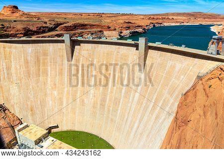 Glen Canyon Dam At Colorado River In A Sunny Day, Arizona, Usa