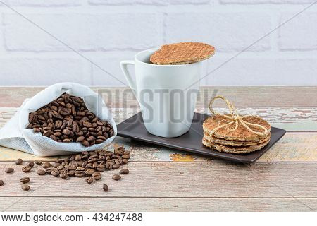 Stroopwafel Cookies Served With Cup Of Coffee.
