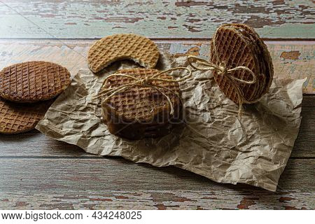 Low Key Photography. Stacking Stroopwafels With A Sisal Loop, Alongside Other Cookies.