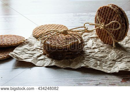 Low Key Photography. Stacking Stroopwafels With A Sisal Loop, Alongside Other Cookies (side View).