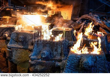 Liquid Metal Is Poured Into Steel Molds From A Metallurgical Ladle.