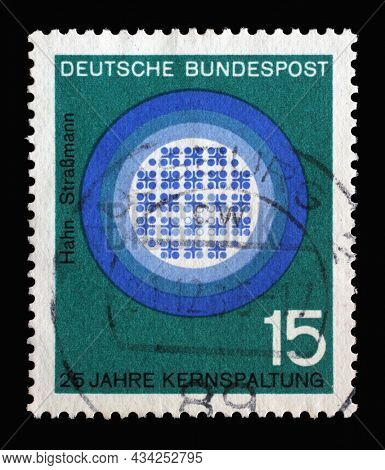 ZAGREB, CROATIA - JUNE 27, 2014: Stamp printed in Germany showing 25th anniv. of publication of Hahn-Strassmann treatise on splitting the nucleus of the atom, circa 1964
