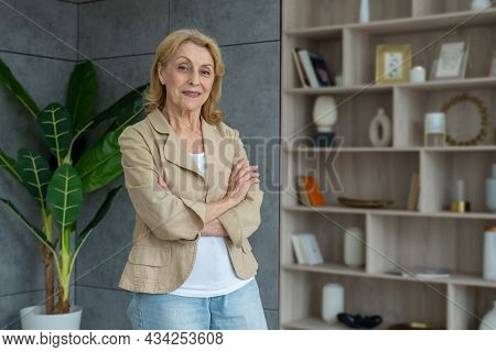 Happy Mature Business Lady Of The 70s, Standing In The Room. Senior Middle-aged Older Stylish Female