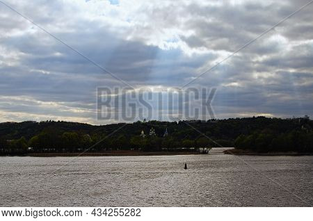Cloudy Landscape Of Kyiv. Bad Weather Cityscape. Churches On The Green Hills In The Background. The