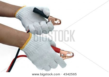 Hands and gloves with car jump start cables poster