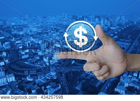 Money Transfer Flat Icon On Finger Over Modern City Tower, Street, Expressway And Skyscraper, Busine