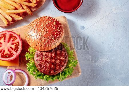 Burger Ingredients, Shot From The Top With A Place For Text. Hamburger Beef Steak And French Fries,