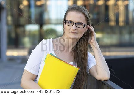 Middle Aged Woman With Documents In Hands. Smart Business Lady, Businesswoman, Thoughtful Teacher, P