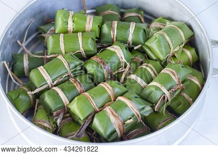 Raw Steamed Sticky Rice With Banana Or Thai People Call Khao Tom Mud In Steamer Prepare For Steaming