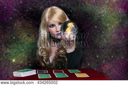 Psychic With Blond Hair Crystal Ball And Tarot Cards On Galaxy Background