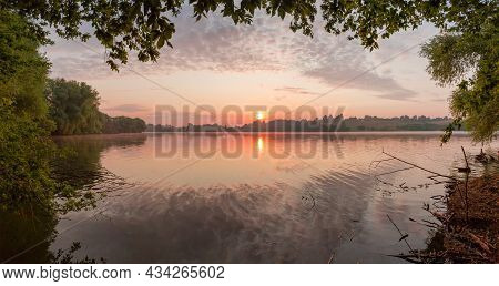 Lake In Calm Partly Cloudy Weather At Summer During Sunrise, Panoramic View With Hanging Trees Branc