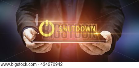 Close Up Of Businessman Hands Holding Tablet With Glowing Shutdown Text. Force Restart And Device Re