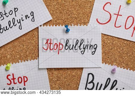 Notes With Phrase Stop Bullying Pinned To Cork Board, Closeup