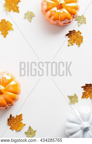 Autumn Flat Lay Composition With Pumpkins And Maple Leaves On A White Background. Autumn, Fall, Than