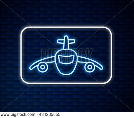Glowing Neon Line Plane Icon Isolated On Brick Wall Background. Flying Airplane Icon. Airliner Sign.
