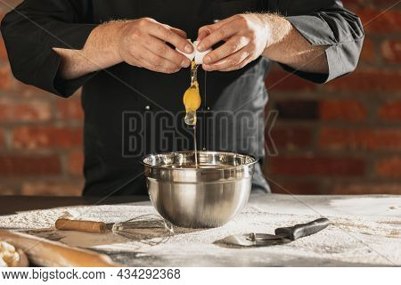 Cropped Image Of Male Chef, Cook In Black Kitchen Uniform Make Bread Dough At Cafe, Restaurant Kitch