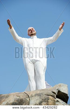 Muslim pilgrim praying on Jabal Arafat in Mecca for Hajj